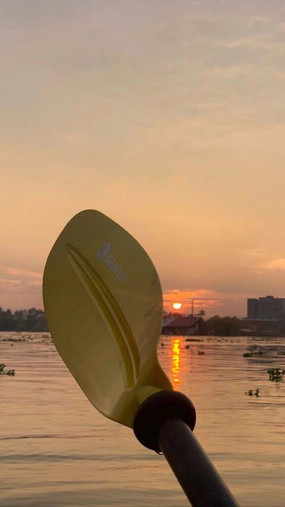 Sunset and the kayak paddle